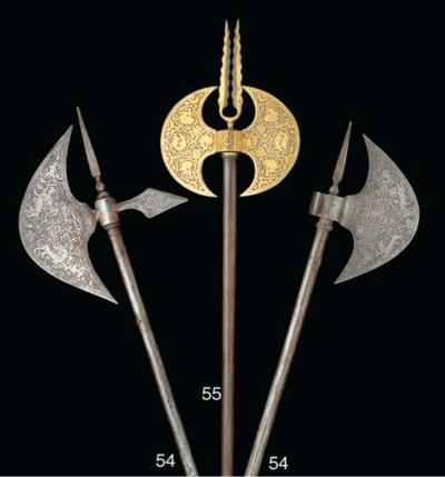 Two similar Qajar steel axes,
