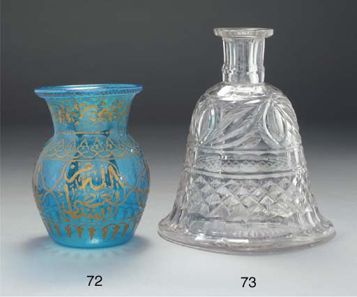 A pale green glass mosque lamp