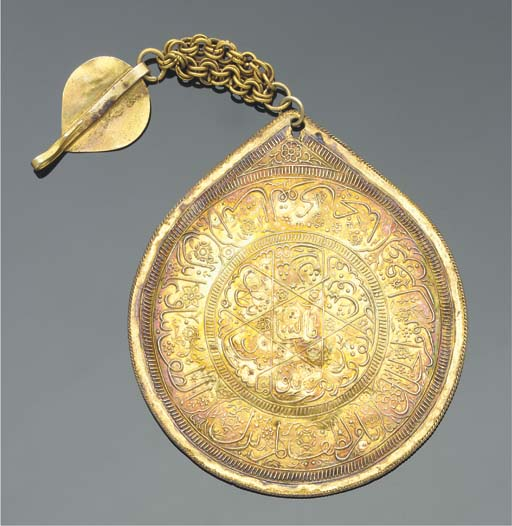 A stamped white metal pendant,
