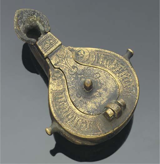 A bronze oil lamp, Iran, 12th