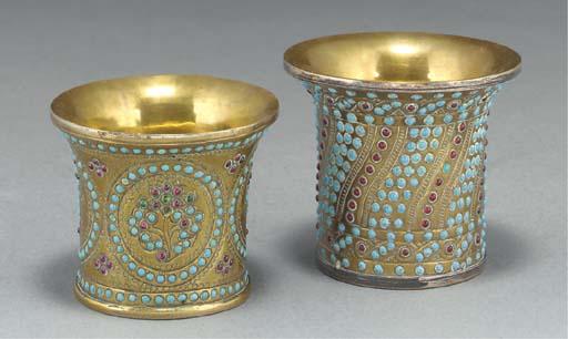 Two Qajar embellished brass na