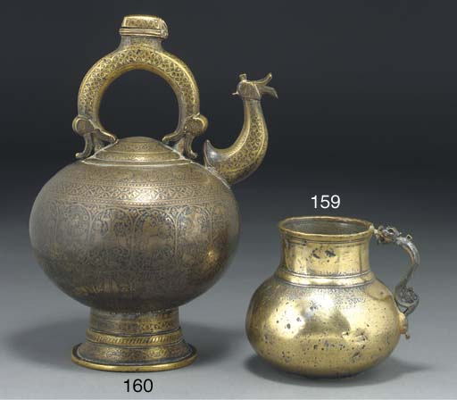 A brass ewer and cover, Iran,