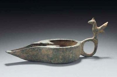 A bronze oil lamp, Maghreb, 10
