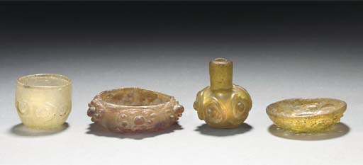 A group of four small glass ve