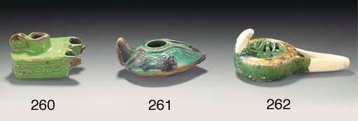 A Fatimid green glazed oil lam