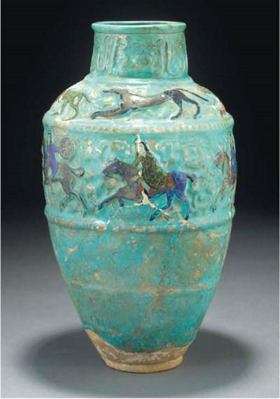 A Mina'i turquoise glazed pott