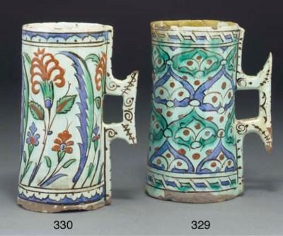 An Ottoman Iznik pottery mug,
