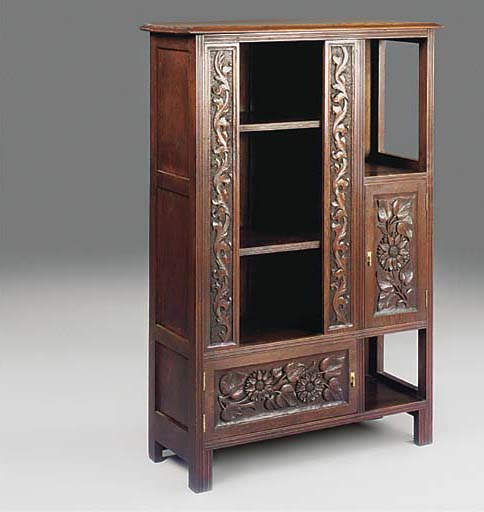 A CARVED MAHOGANY DISPLAY CABI
