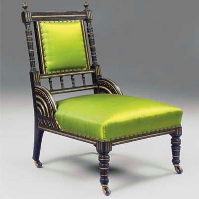 AN EBONISED MAHOGANY LOUNGE CH