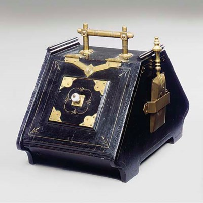 AN EBONISED WOOD AND BRASS BEN