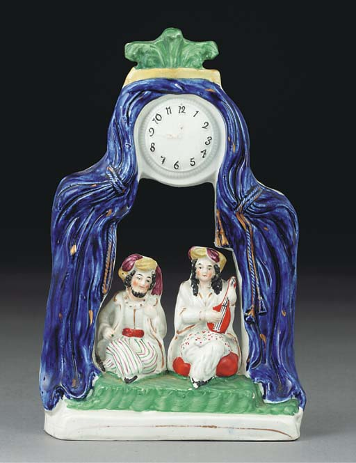 A Staffordshire pottery clock-