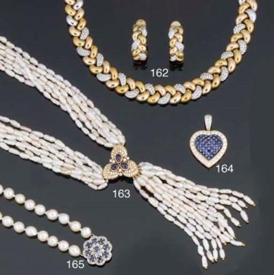 A sapphire and diamond heart p