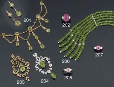 A group of peridot jewellery
