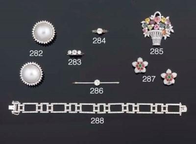 A diamond and multi-gem brooch