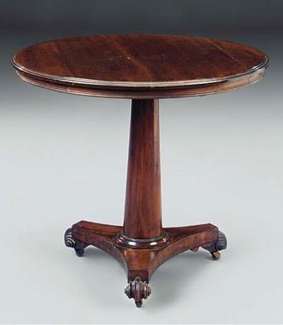 A mahogany circular table