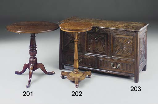 An oak tilt-top tripod table