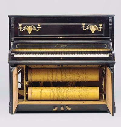 A barrel piano with keyboard,