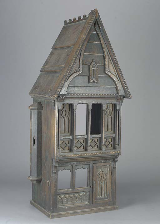 A carved wood toy house in the