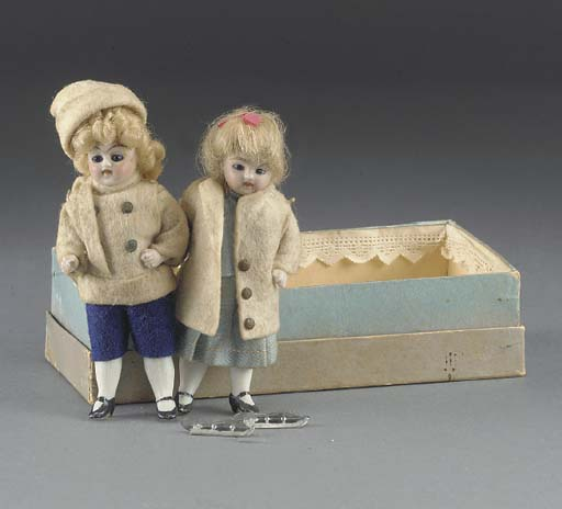 A pair of all-bisque dolls' ho