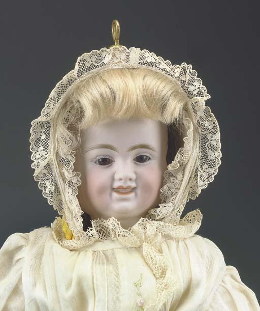 A Carl Bergner three-faced dol