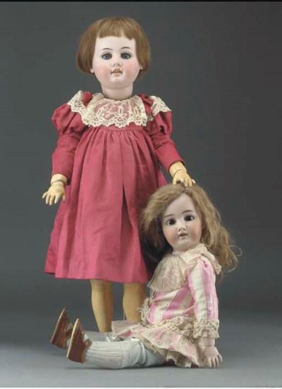 A bisque headed 1904 Child Dol