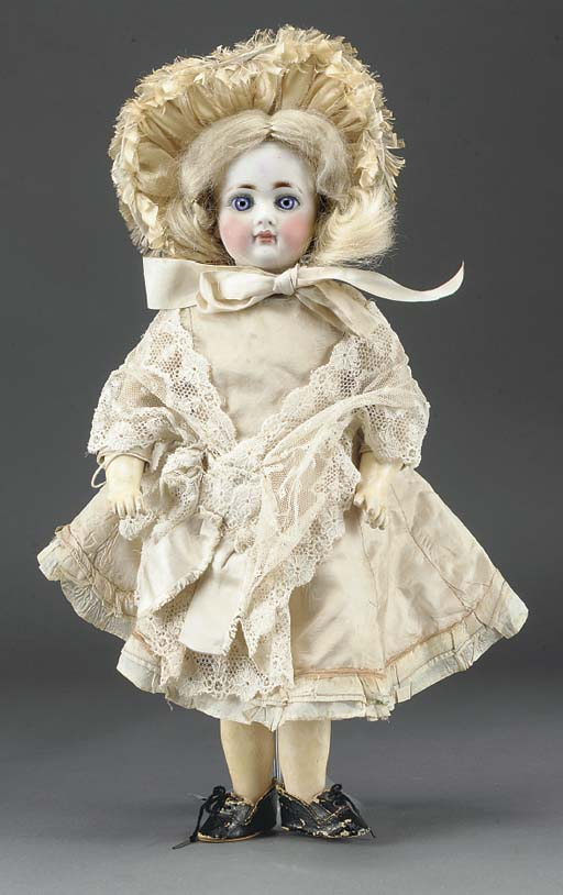 A bisque headed Child Doll