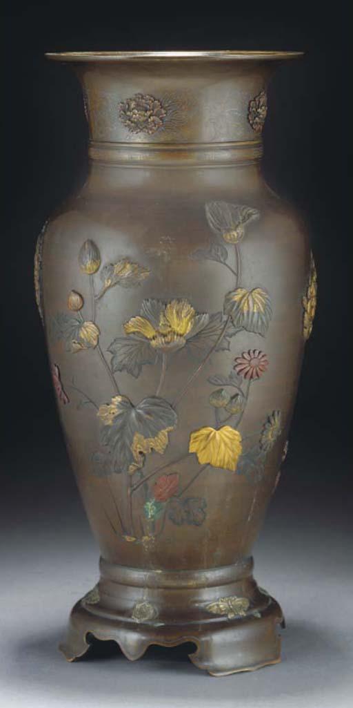A Japanese tapering bronze vas