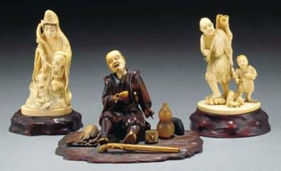 A JAPANESE WOOD AND IVORY OKIM