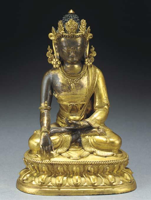 A Tibetan parcel-gilt bronze m