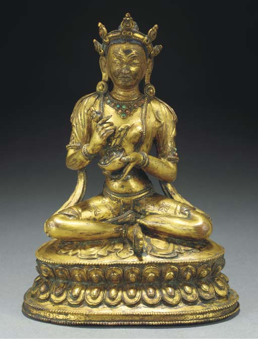 A Tibetan gilt-copper figure o