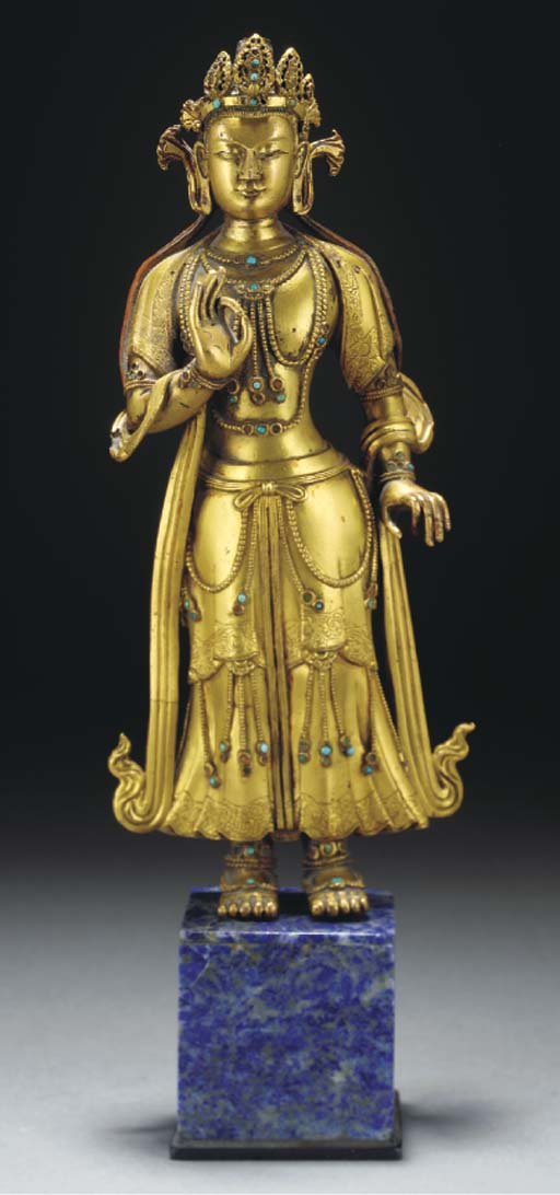 A Tibetan gilt copper figure o