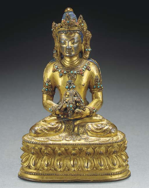 A Tibetan gilt-copper model of