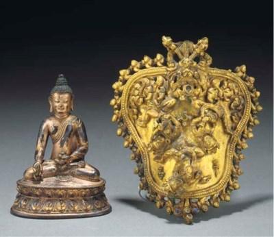 A Tibetan gilt bronze fragment