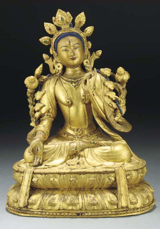A Tibetan gold lacquer model o