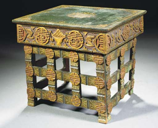 A Tibetan carved and painted w