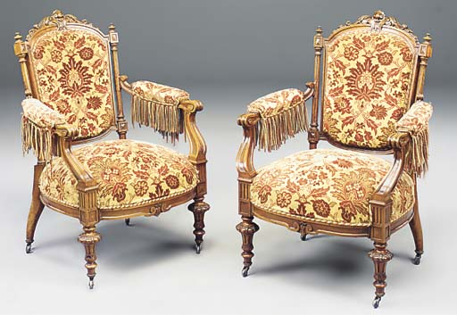 A PAIR OF FRENCH CAREVD WALNUT