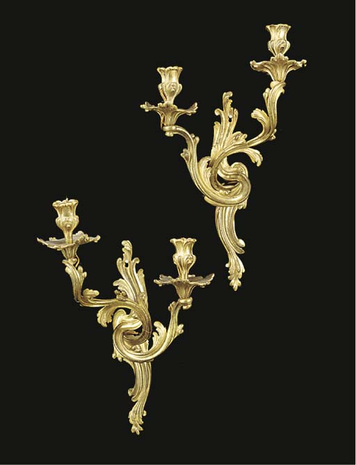 A pair of gilt bronze twin lig