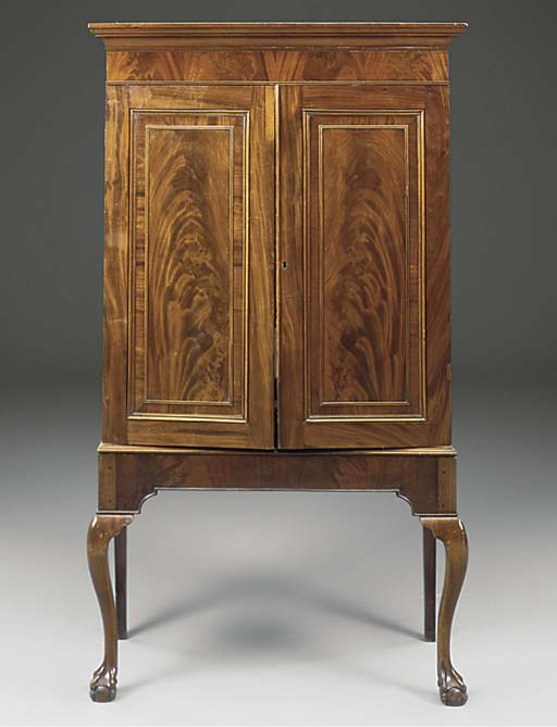 A MAHOGANY CABINET ON STAND