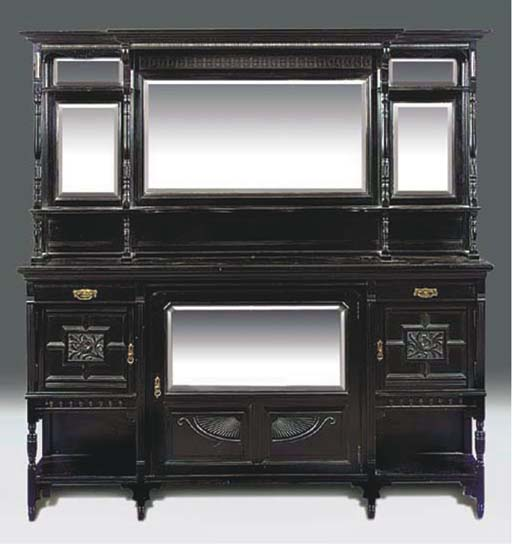 A LATE VICTORIAN EBONISED MIRR