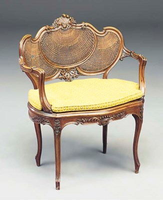 A FRENCH CARVED WALNUT FAUTEUI