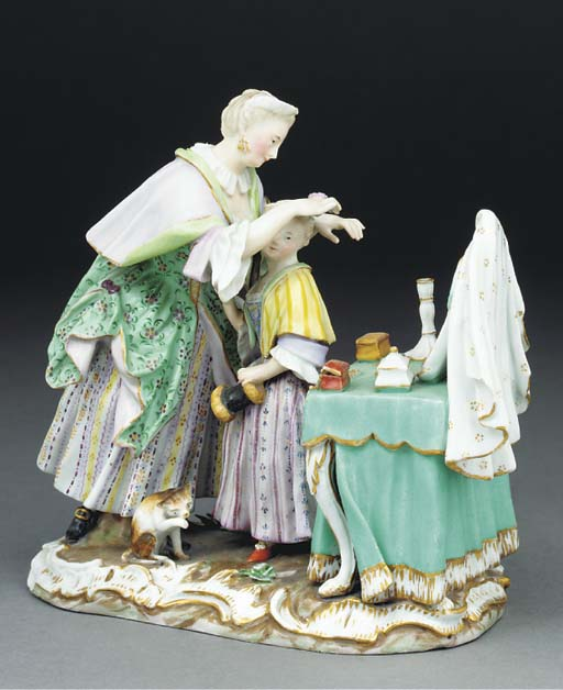 A Meissen group of figures at