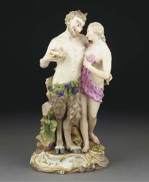 A Meissen group of a satyr and