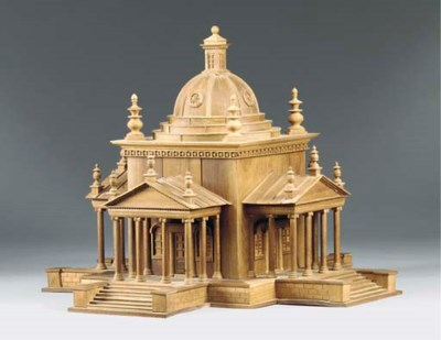 A CARVED HARDWOOD MODEL OF THE