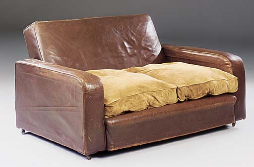 A LEATHER-UPHOLSTERED SETTEE