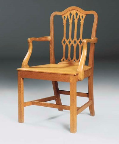 AN EDWARDIAN OAK ARMCHAIR