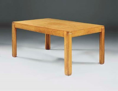 AN ART DECO WALNUT DINING TABL
