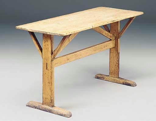 AN ENGLISH PINE TAVERN TABLE