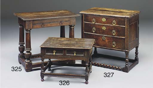 AN ENGLISH OAK CHEST OF DRAWER