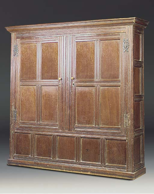 AN ENGLISH OAK PANELLED CUPBOA