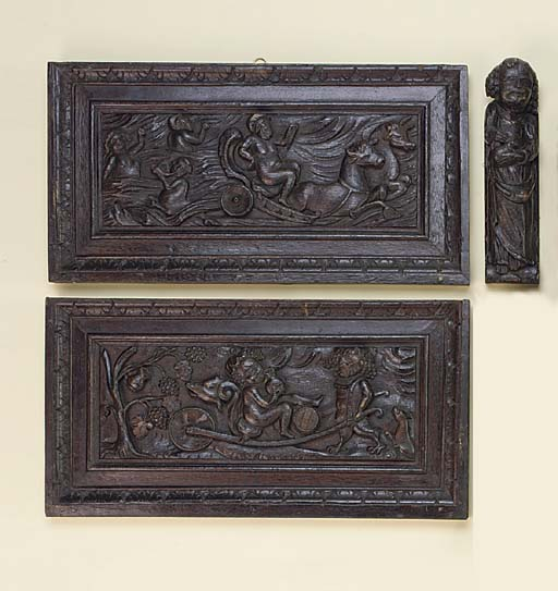 A pair of Dutch relief carved